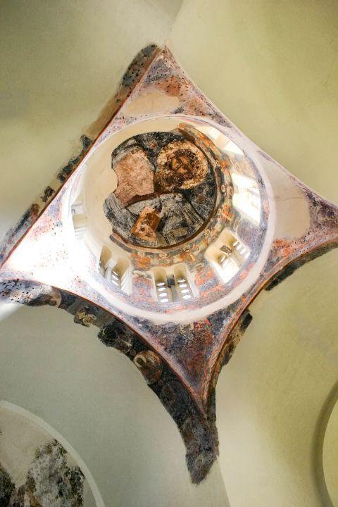 A fresco painting of Jesus Christ inside the church of Agioi Apostoli.