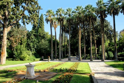When entering the National Garden, a sundial, beautiful flowers and trees draw your attention.