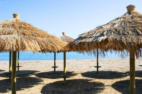 Relax on Loutsa beach, under the refreshing shade of some lovely umbrellas.