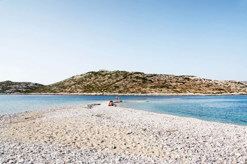 Pebbled, tranquil beach with clear waters. Agios Pavlos beach, Amorgos.