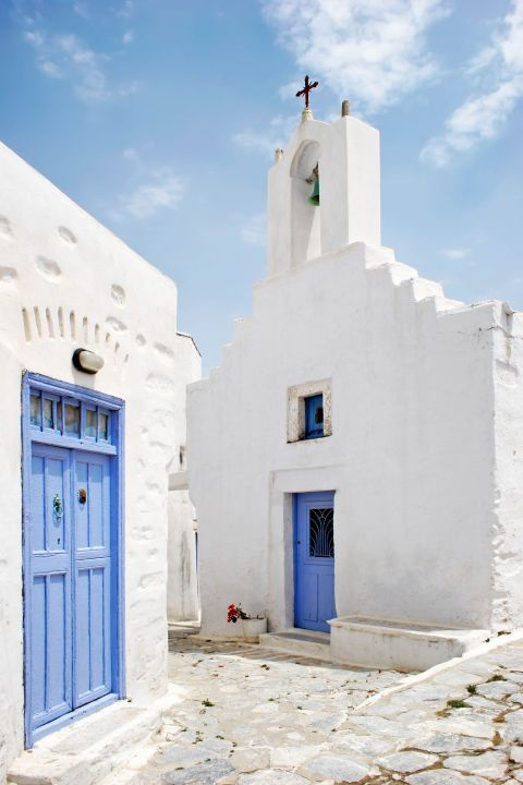 White coloured chapel with blue details