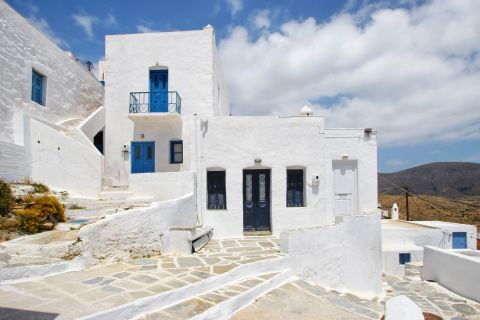All houses in Chora are painted in white and blue colors, according to the Cycladic aesthetics.