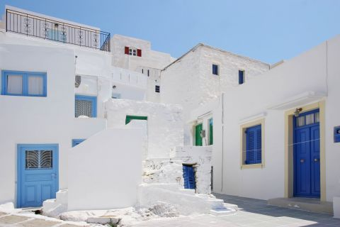 Quiet alleys, formed by whitewashed houses with blue-colored details.