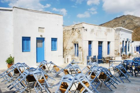 Tables of local eateries. Chora, Serifos.
