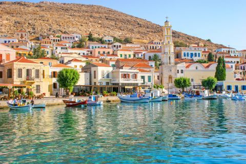 Fishing boats, cafes and traditional buildings in Nimporio