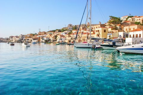 Sailing boats, mooring on the crystal clear waters of Nimporio
