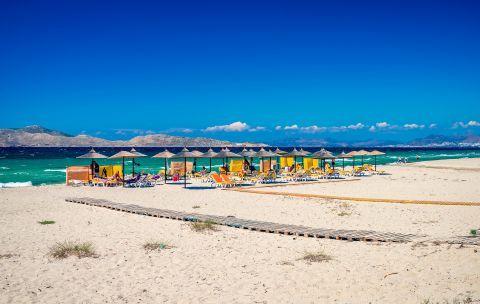 Umbrellas and sun loungers on Marmari beach.