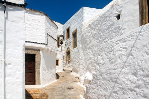 Whitewashed buildings with wooden details. Patmos island.