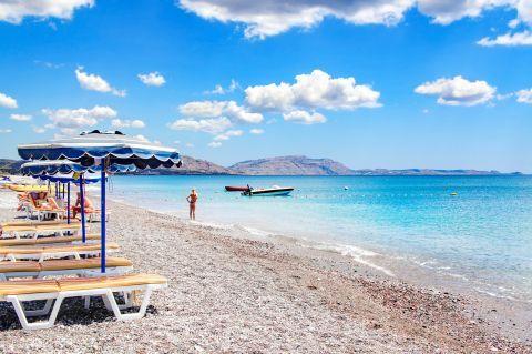 Umbrellas and sun loungers on Genadi beach.