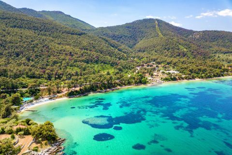 Turquoise waters and green hills. Papalimani beach, Thassos.