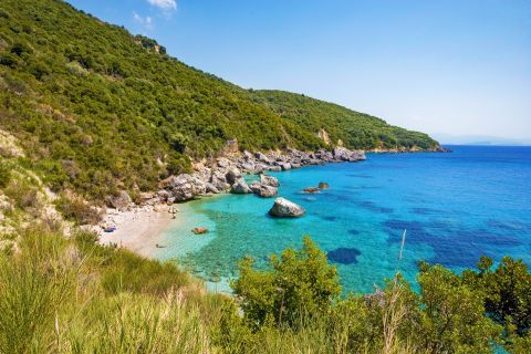 The secluded Agios Sostis beach. An unspoiled place with dense vegetation and clear waters.
