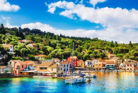 Lovely, colorful houses. View of the port of Paxi.