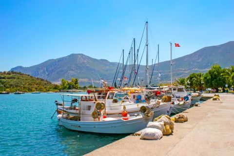 Fishing boats, mooring on the small harbor of Ancient Epidaurus village