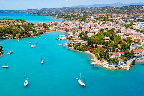 Turquoise waters, beautiful houses and vegetation. View of Porto Heli.