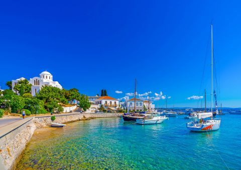 Sailing boats, mooring on the turquoise waters of Spetses