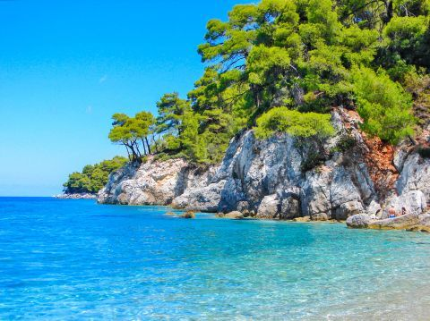 Azure waters, rock formations and vegetation in Skopelos
