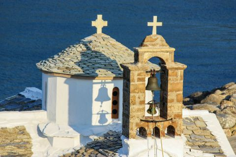 A stone built belfry and dome of a beautiful chapel on Skopelos.