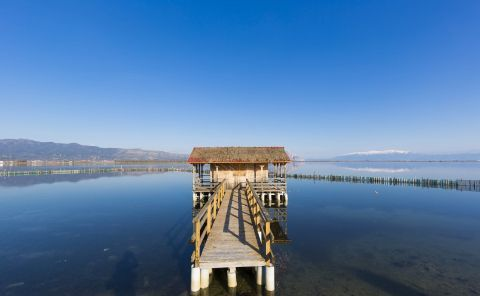 A wooden cabin that seems to float on the crystal clear waters of the Sea Lake in Mesolongi.
