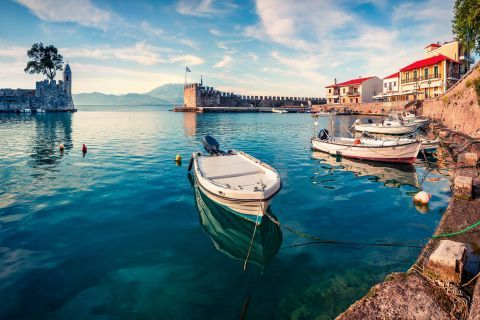 Small, fishing boats, mooring on the blue waters of Nafpaktos