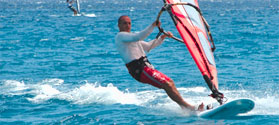 Try windsurfing in Milos