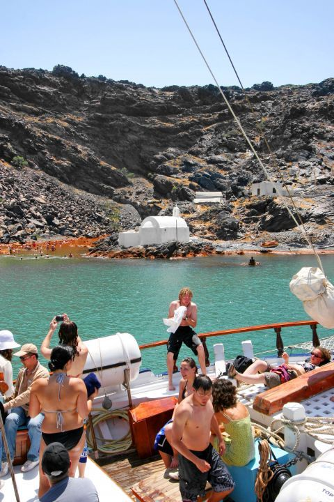 Santorini's visitors on a cruise around the island's hot springs