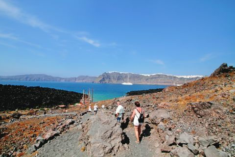 Santorini's volcanic land is popular to many tourists