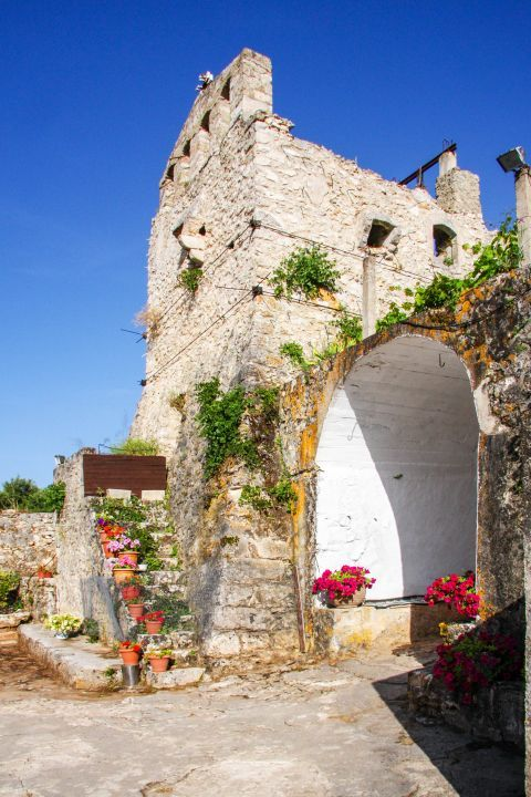 Monastery of Anafonitria: A beautiful spot under the belfry, where lovely flower pots are placed.