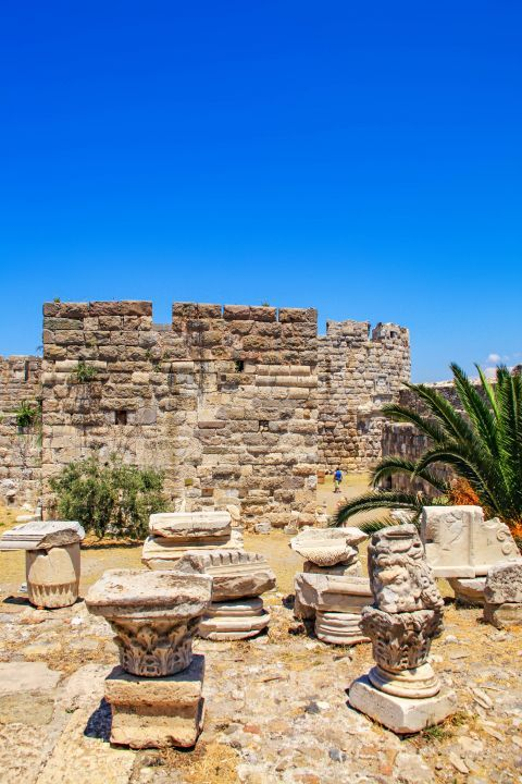 Nerantzia Castle: A number of garlands and masks from Hellenistic times contrast with the walls of the Castle.