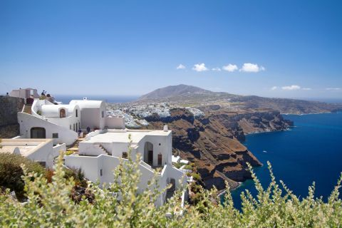 Cycladic houses and abrupt cliffs are found in Caldera