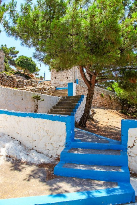 Agios Ioannis Monastery:  A large plane tree throws its shadow on the church