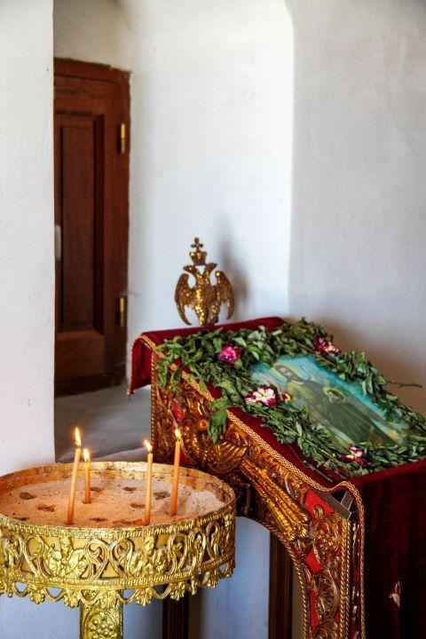 Agios Ioannis Monastery: Candles and an icon of Saint John.
