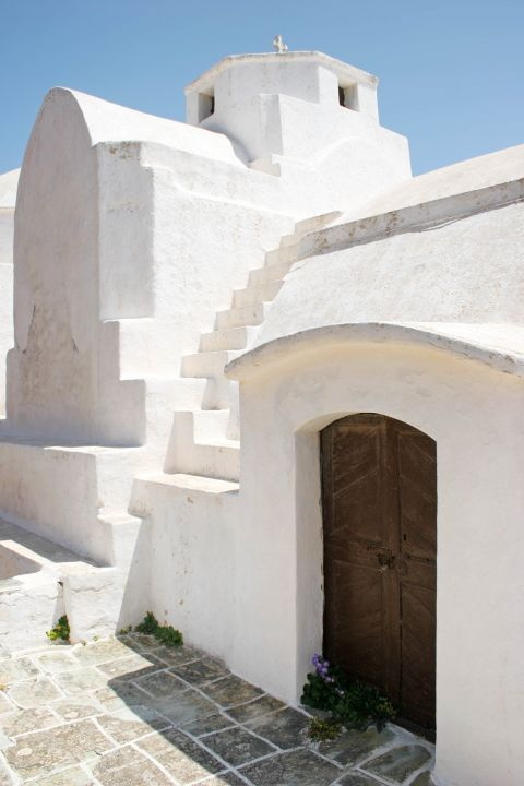 The Church of Panagia is a white church with wooden details