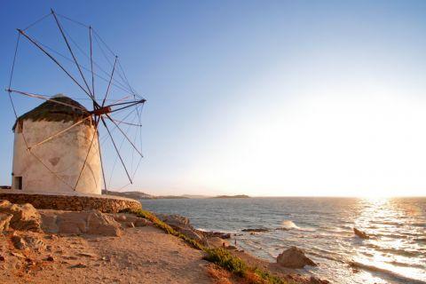 Windmills: A Cycladic windmill by the seaside in Mykonos