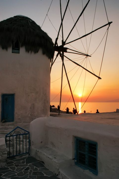 Windmills: Beautiful view of a windmill during sunset