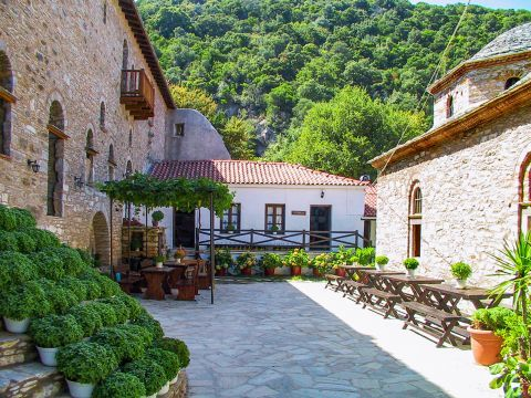 Monastery of Evangelistria: It is built on the slopes of a mountainside and it is surrounded by lush greenery.