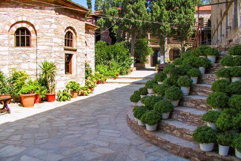 Monastery of Evangelistria: Stone-built premises and lots of flowers.
