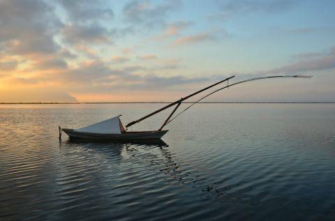 Sea Lake: A fishing boat, mooring on the waters of the Sea Lake of Mesolongi