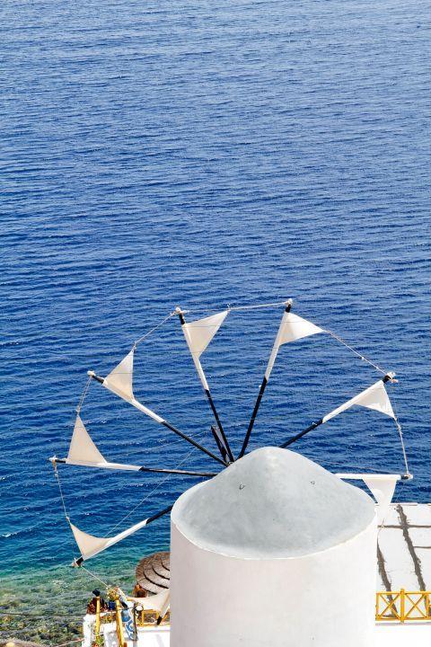 Thirassia Island: A windmill in Thirassia, overlooking the sea