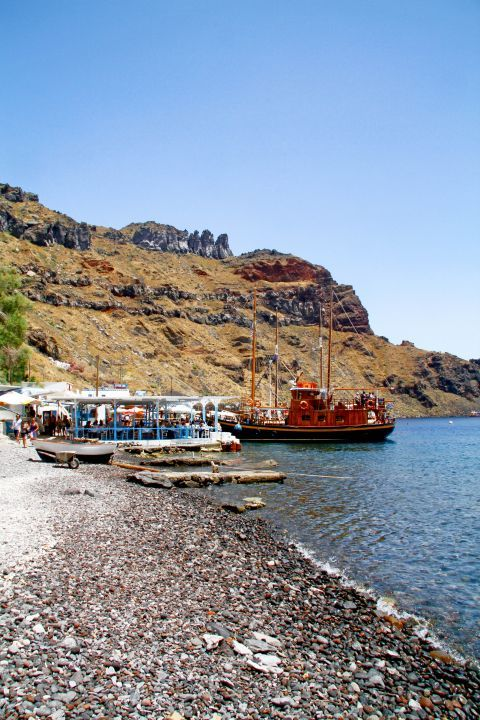 Thirassia Island: A local eatery and an old ship by the seaside of Thirassia