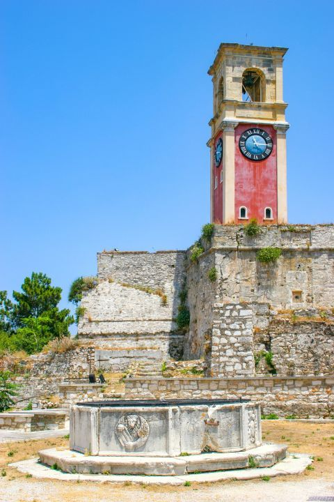 Old Fortress: A beautiful polygonal well and a tall clock tower