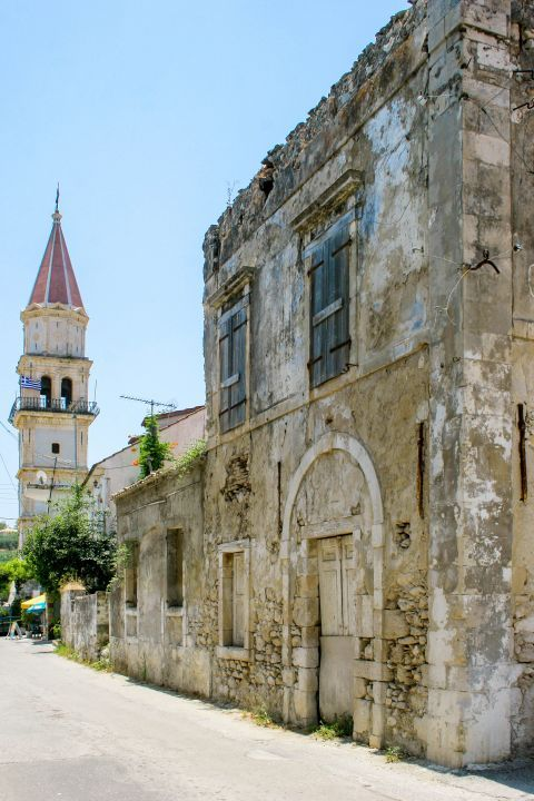 Maherado: An old, half-ruined mansion and the Venetian belfry of the Church of Agia Mavra.