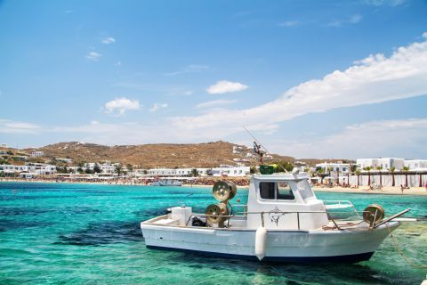 Ornos: A fishing boat on the azure waters of Ornos