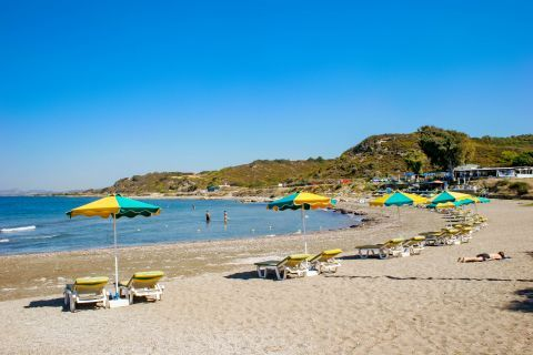 Kamiros: Umbrellas and sun loungers on Kamiros beach.
