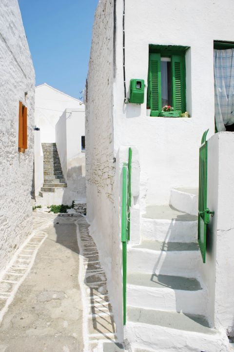 Driopida: A white house with green windows