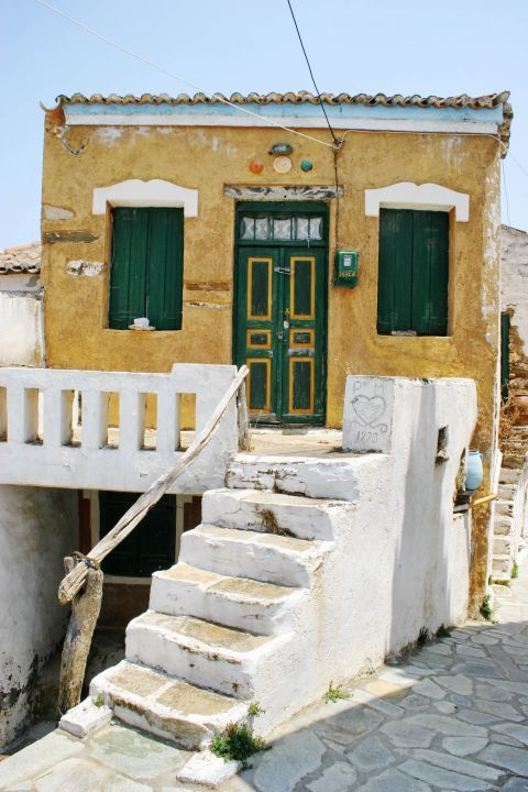 Driopida: An old, colorful house.