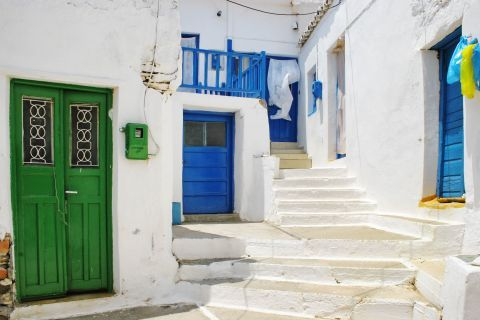 Driopida: Blue and green doors on whitewashed buildings