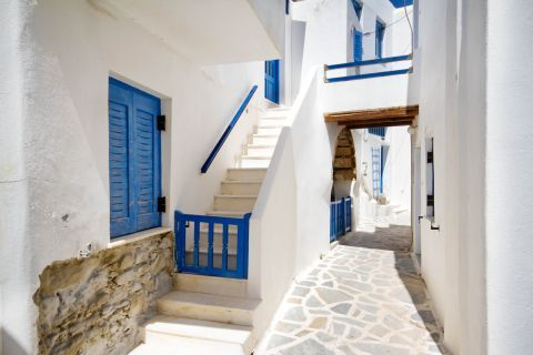 Town: Whitewashed Cycladic house with blue-colored details