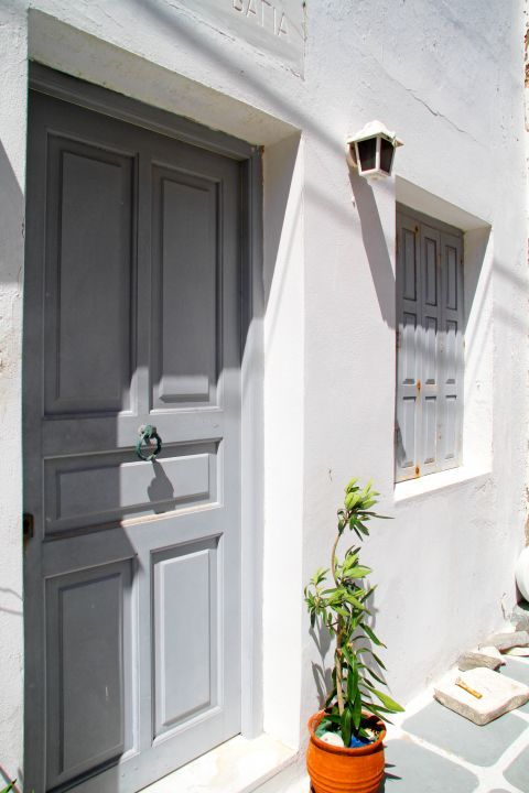 Naoussa: A grey-colored door and windows