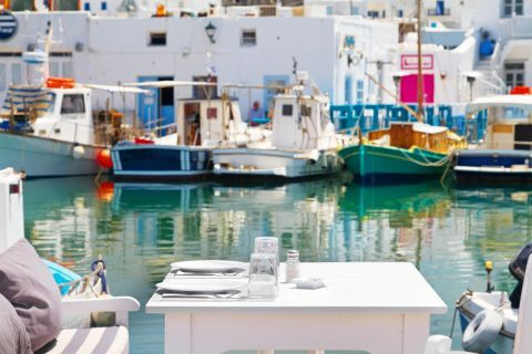 Naoussa: Outdoor seating of a local tavern by the sea