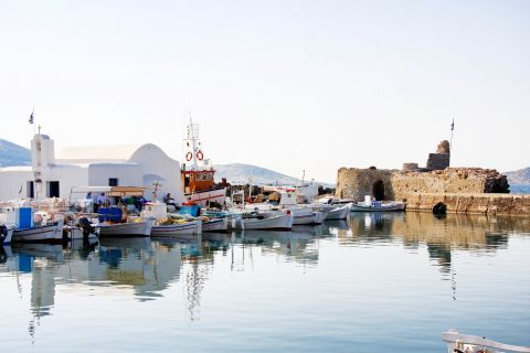Fishing boats, a small church and the Venetian Castle of Naoussa